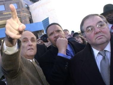 Mayor Rudolph Giuliani gestures as he makes a comment about the remains of the former World Trade Center site to Mayor Marc Morial of New Orleans, and Richard J. Sheirer, far right, Director of Mayors Office of Emergency Management Jan. 26, 2002.