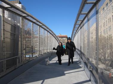 Joanna Kerry and her dog Murray (left) were happy to have the E. 78th Street pedestrian bridge back.