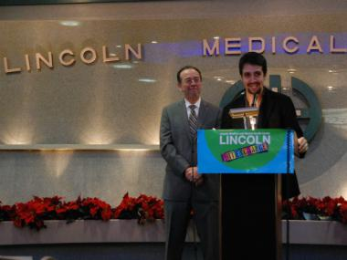 Actor and composer Lin-Manuel Miranda describes a new health care barter program for artists.  Beside him is Alan Aviles, Lincoln Hospital executive director.