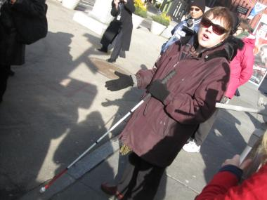 Annalyn Barbier, from VISIONS, demonstrated the difficulties of navigating the new Union Square pedestrian plaza.