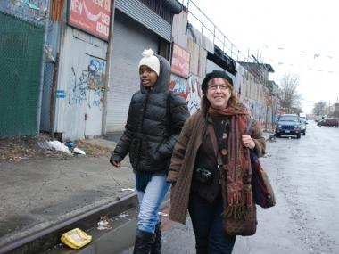 Tara Murray and Lois Stavsky (r) walk down Drake Street during a search for street art in the Hunts Point section of the Bronx.