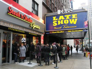 Customers line up outside of Steak 'n Shake, next to the Late Show's studios.