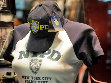 Police Commissioner Raymond Kelly banned off-duty cops from wearing clothing with NYPD logos or insignias.