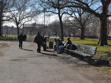 A group of homeless men sat on McCarren Park's benches. The Greenpoint shelter on McGuiness Boulevard will serve homeless men from all over the city.