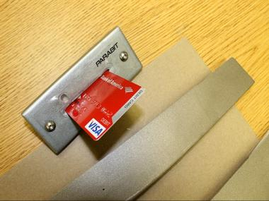 The device on the door captures users' bank card numbers, police said.