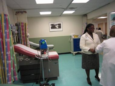 Harlem Hospital Executive Director Denise Soares talks to staff in the hospital's new Fast Track unit which allows visitors to the emergency room with non-emergent problems to be seen quicker.