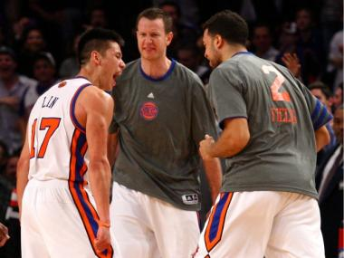 Jeremy Lin celebrates with Knicks teammates Steve Novak and Landry Fields after draining a three-pointer against the Lakers.