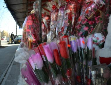 A stand at Atlantic Avenue and Rockaway Boulevard in Queens sells artificial flowers among other Valentine's Day gifts. Local florists charge such stands steal their business.