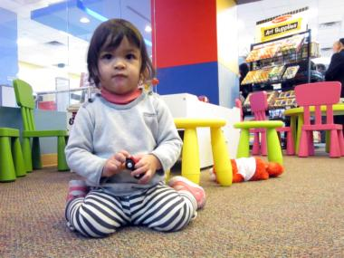 Isla Lo Presti, 20 months old, played at J&R Jr. on its opening day Feb. 13, 2012.