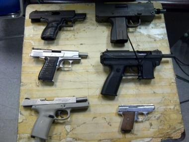 Police arrested a man and woman in the Bronx on Monday after discovering six firearms in their residence.