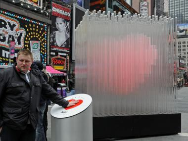 A glowing heart sculpture is in Times Square from Feb. 6 to 29, 2012.