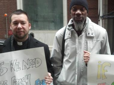 Rev. Ruben Austria and A. Mychal Johnson (r) opposed city subsidies for FreshDirect at a public hearing in February. Johnson also has concerns about the proposed Cookies Kids.com benefits package.