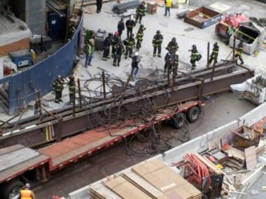 A load of steel beams fell onto a truck at the World Trade Center construction site Feb. 16, 2012.