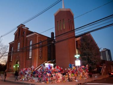 A makeshift memorial prior to the funeral services for Whitney Houston at the New Hope Baptist Church in Newark, N.J., on Sat., Feb. 18, 2012.