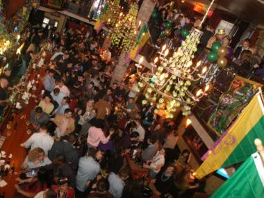 Patrons at the Bourbon Street Bar and Grill can throw doubloons and beads from the second-floor balcony into the crowd.