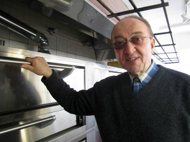 The original owner of Famous Ray's Pizza on Sixth Avenue, Mario DiRienzo, 70, was heating the shop's ovens on Feb. 20, 2012 in preparation to open in late March 2012.