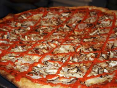 Two Boots pizza is known for its crisp cornmeal crust and fanciful toppings.
