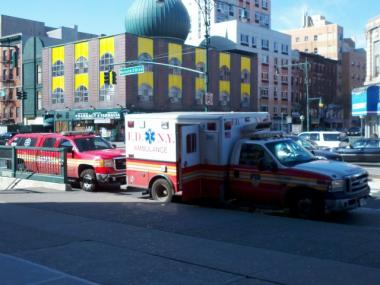 A woman hit by an EMS ambulance at 116th Street and Lenox Avenue on Tuesday was then treated by the same ambulance, witnesses said.
