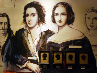 The back wall of the exhibit features a large mural of Percy and Mary Shelley.