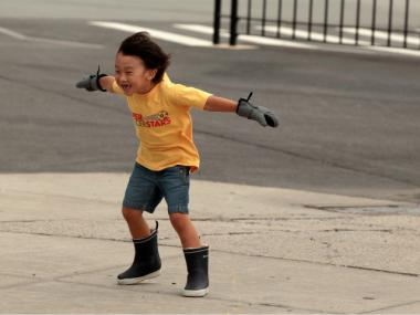 A young boy enjoyed the wind in Lower Manhattan during Hurricane Irene Aug. 28, 2011.