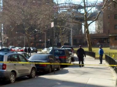 Police canvass Baruch Drive after a shootout on Feb. 27, 2012.
