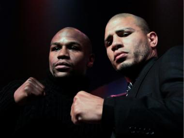 (L) Floyd Mayweather and (R) Miguel Cotto pose at a press conference to promote their upcoming fight on May 5 at the MGM Grand in Las Vegas at the The Apollo Theater on February 28, 2012 in New York City.