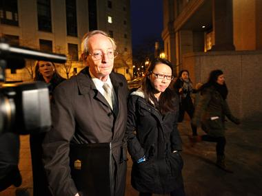 Jia Hou,25, leaves Manhattan Federal Court with lawyer Martin Adelman on Feb. 28th, 2012