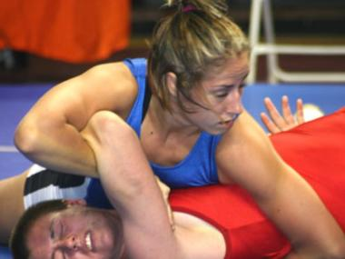 Olympic wrestler Marcie Van Dusen is on the American team.