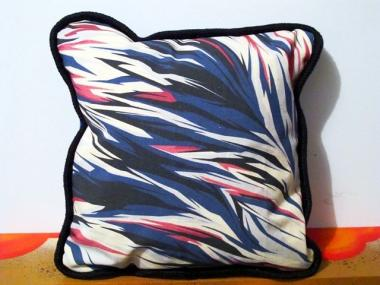 Arist SEE ONE, aka Jemal McClary, faced criminal charges for selling painted pillows like this one on a corner in SoHo.