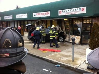 An SUV smashed into a Linden Boulevard shopping strip on Thursday.