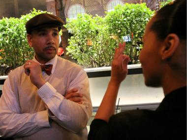 "Bronx Borough President Ruben Diaz Jr. speaks with a Bronx actress, Eve Lora, at a ""Facebook Meet and Greet"" on March 1, 2012."
