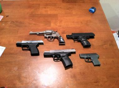 Handguns were seized during a police raid in Queens.