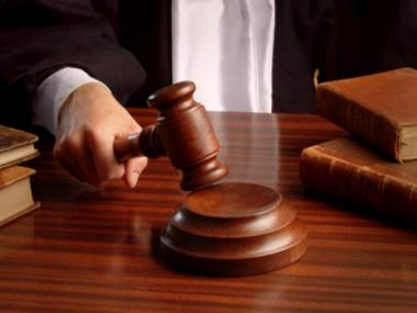 Thomas Parkin, 51, was sentenced to at least 13 2/3 years in prison for fraud and other charges May 21, 2012.