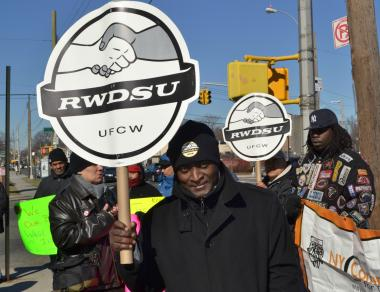 Protesters rally for improved pay and treatment of car wash employees outside the Metro Car Wash in Forest Hills on Tues., March 6, 2012.