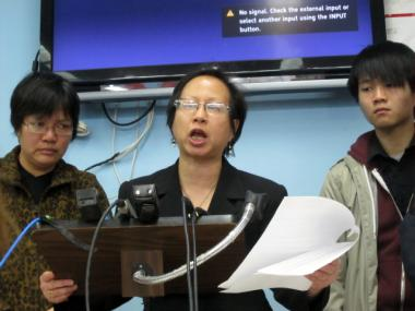 Elizabeth OuYang (center), president of OCA-NY, an Asian American advocacy group, stands with Su Zhen Chen, Danny Chen's mother, and Banny Chen, Danny's cousin, at a press conference March 6, 2012.