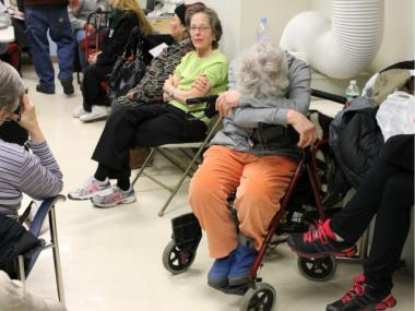 Irini Sadek, 77, waited for two-and-a-half hours to be admitted into a public hearing on Mar. 6, 2012 on plans for the St. Vincent's Hospital redevelopment. She is seen resting in an overflow room where she was sent.