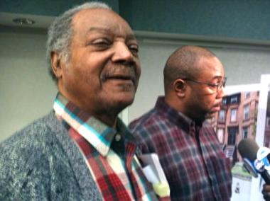 Ernest Leaker (l.) stood with his son, Reginald Leak, at the Brooklyn DA's office Weds., March 7, 2012.