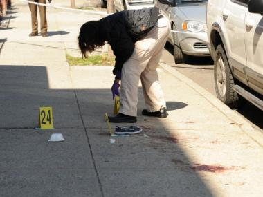 A crime scene investigator works the scene at 2272 Strauss St. in Brooklyn on March 7, 2012.