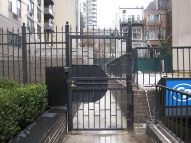 Residents at 303 E. 83rd St. said the gate went up at least a year ago, locking off a space that once housed a playground.