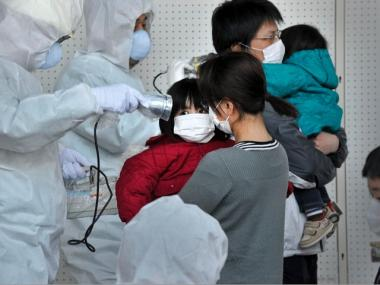 Children were tested for radiation in Japan in March 2011.