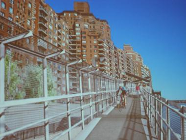 Photo of a rendering of the the two-block-long ramp to be built along the East River, connecting the esplanade to where it ends about East 81st street with stairs leading to a promenade.
