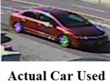 Police say suspects used red Honda Civic to get away after an alleged rape and robbery in a Marine Park business.