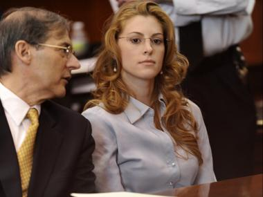Jaynie Baker and her attorney Robert Gottlieb appear in Manhattan Supreme Court on March 13, 2012 for her arraignment on charges of promoting prostitution.