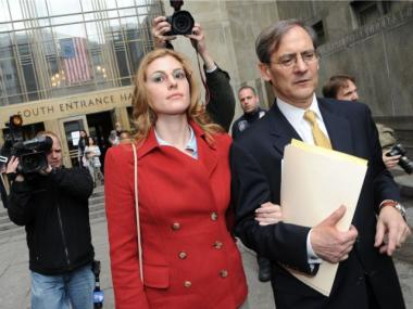 Jaynie Baker leaves Manhattan Criminal Court with her lawyer, Robert Gottlieb, on March 13, 2012 after her arraignment on promoting prostitution charges.