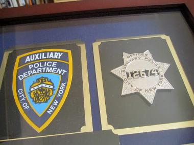 NYPD auxiliary officers wear sheriff-like shields, like Nicholas Pekearo's here.