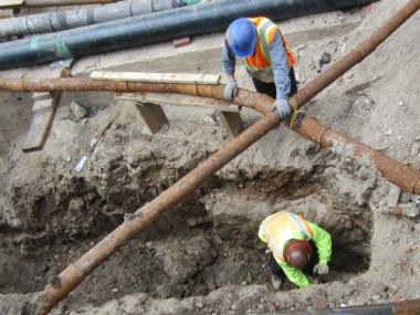 Workers excavate an 18th-century wall found under Fulton Street March 12, 2012.
