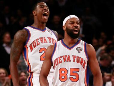 Iman Shumpert and Baron Davis react during the Knicks' 121-79 win over the Portland Trailblazers at Madison Square Garden on Weds., March 15, 2012.