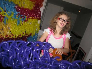 Olek hand-crocheted a long chain of balloons to create the new exhibit