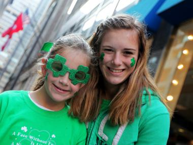 Sisters Mary Kate Person, 8, (l.) and Elise Person, 13, from Philadelphia, enjoying the St. Patrick's Day Parade on March 17, 2012.