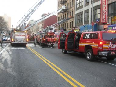 Firefighters battle a blaze at 511 W. 125th St. on March 18, 2012.